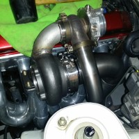 External wastegate setup mounted off turbine housing